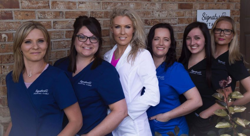The dental team at Signature Dental Care in Hickory Hills, IL